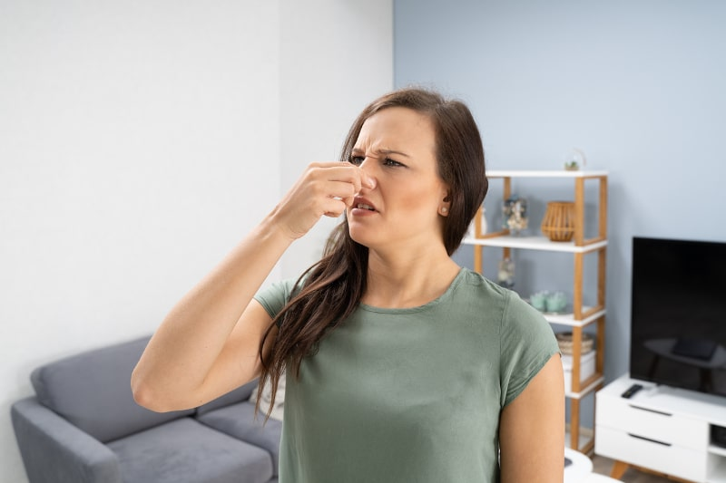 Person holding nose